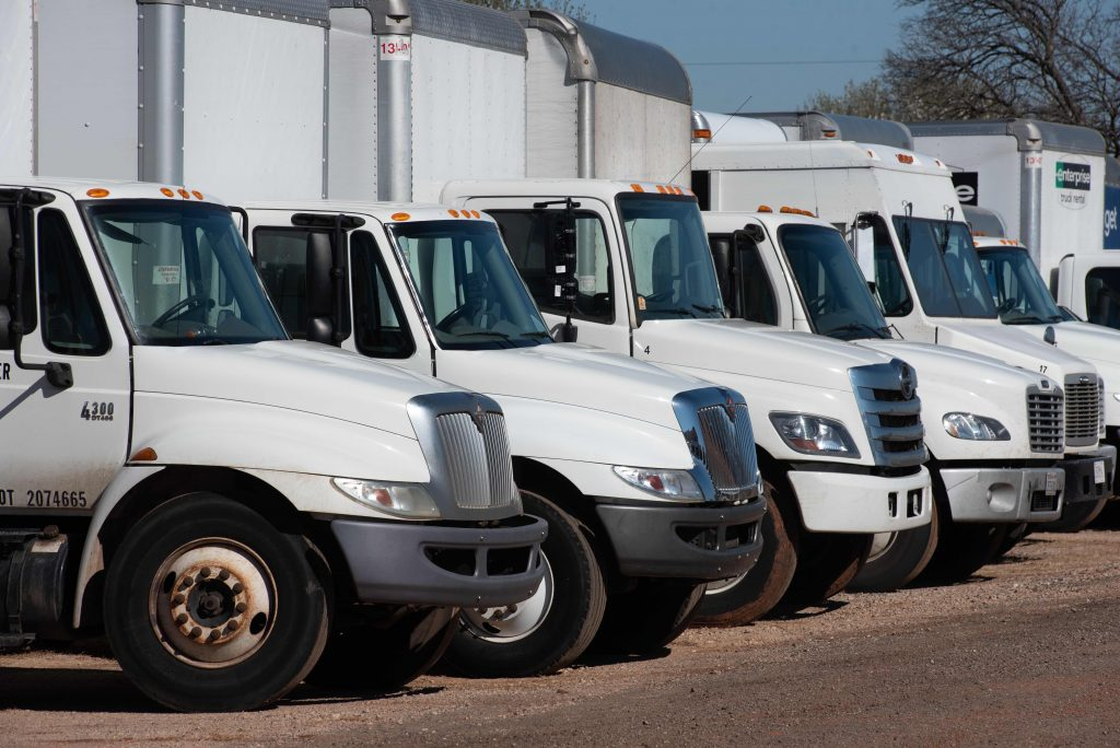 a lineup of commercial trucks and vans
