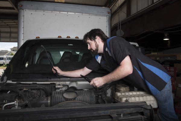 mechanic conducting truck repair and maintenance