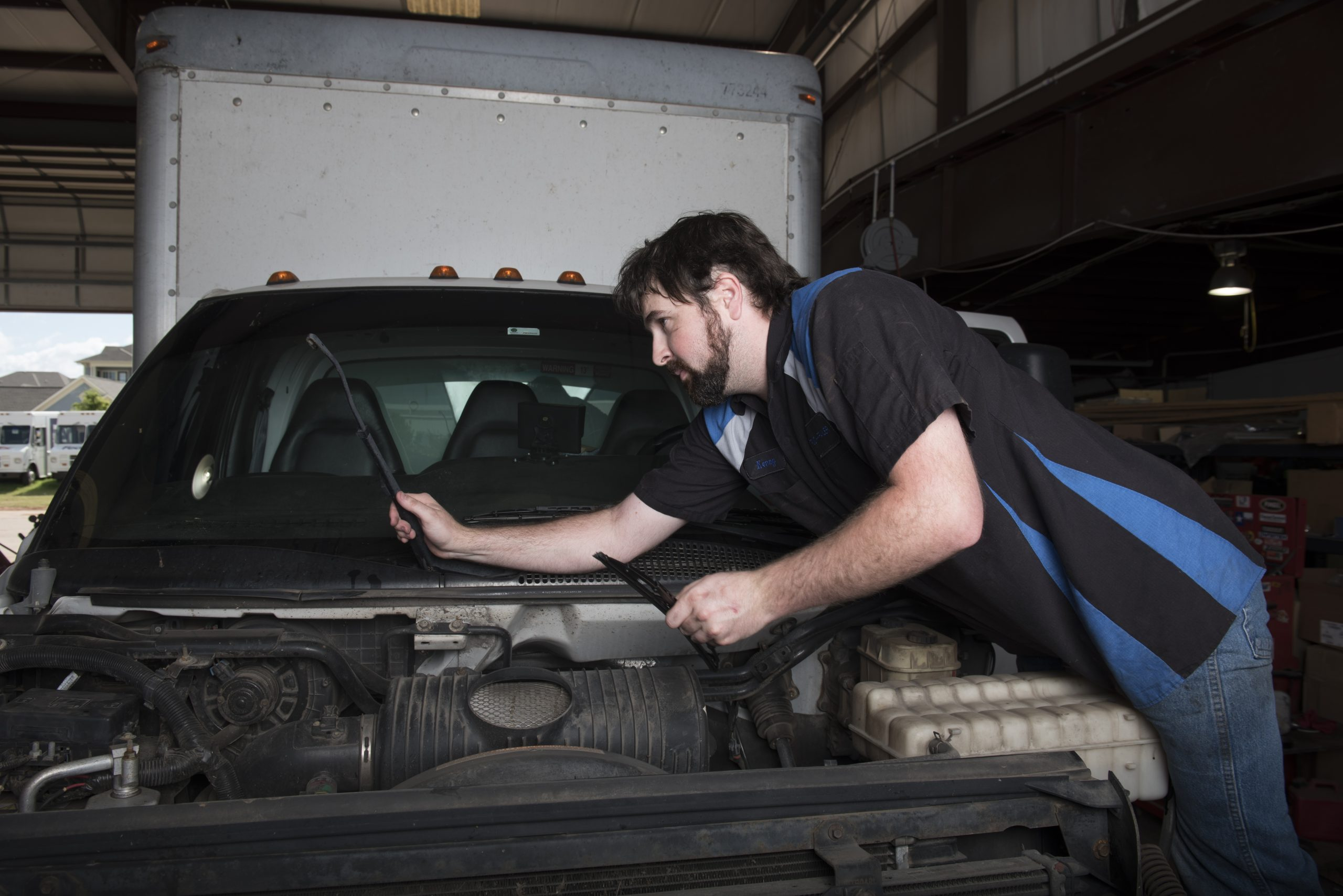 mechanic conducting truck repair and maintenance