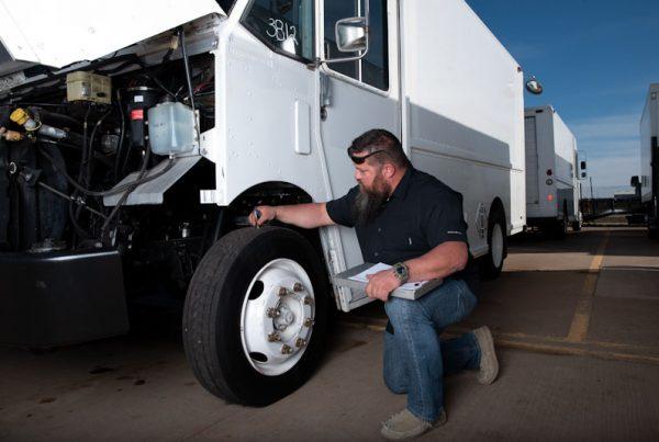 TruckNTrailer mechanic checking a truck